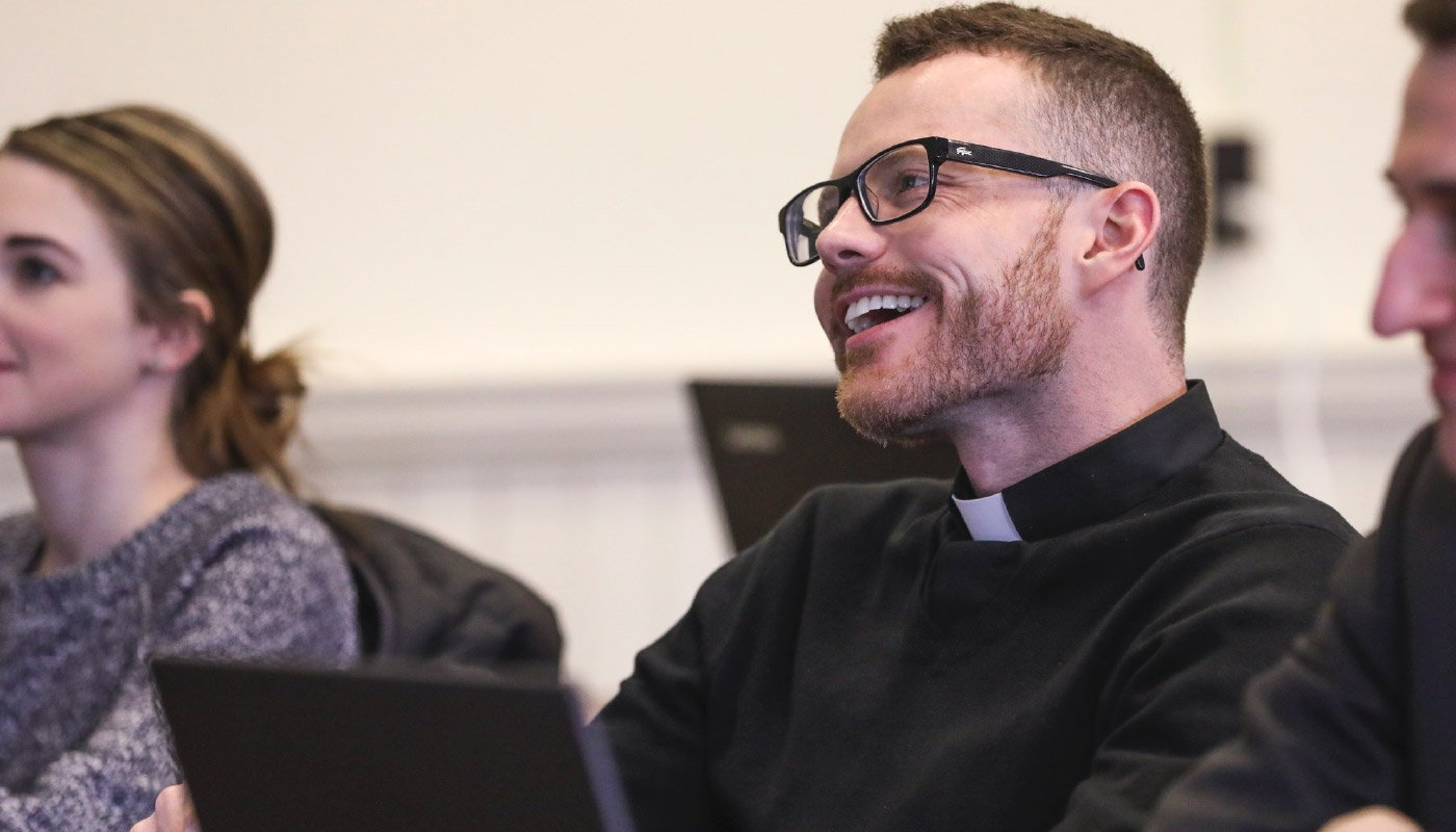 Priest smilling